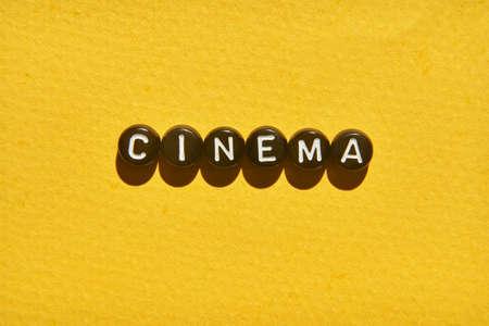 Popcorn quote design. Typography concept. Creative text wallpaper. Phrase yellow background. Cinema concept. Film delicious snack. Black round letters
