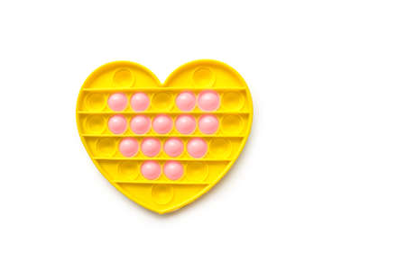 New baby toy. Pop it finger play. Funny color. Hand squeeze round silicone. Change form. Yellow heart shape with double 版權商用圖片