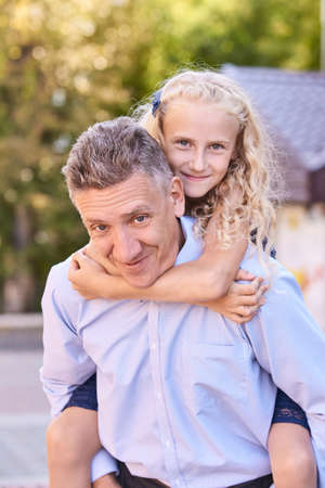 Father with daughter. Happy family portrait. Single parent. Nature autumn background. Two people. Summer park lifestyle. Fatherhood concept. Home outdoors life 版權商用圖片
