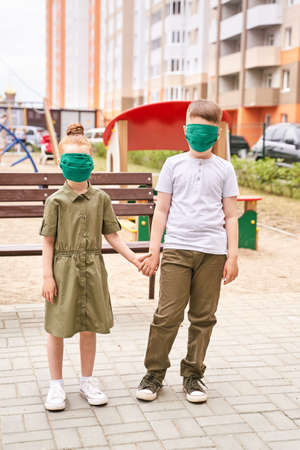Children in safety mask. New normal.