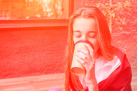 Pretty girl drink beverage outdoors. Buy takeaway coffee in plastic cup. Caucasian real people. Single female person. Staycation concept. Positive attractive human. No Sustainable lifestyle