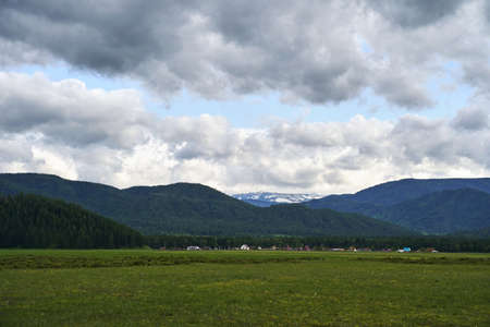 Vacation landscape. Russian Altai mountains. Multa region. Holiday at home. Staycation concept. Long distanse road. Reduce carbon footprint. Sustainable lifestyle. Holiday trail. Local travel Standard-Bild