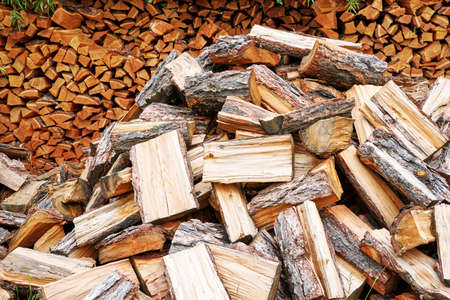 Wood chop stove. Woodpile texture background. Trees store. Hardwood pile stack. Wooden biomass wall. Split forest. Agriculture work Standard-Bild