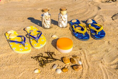 colorful beach accessories on the sand flat lay
