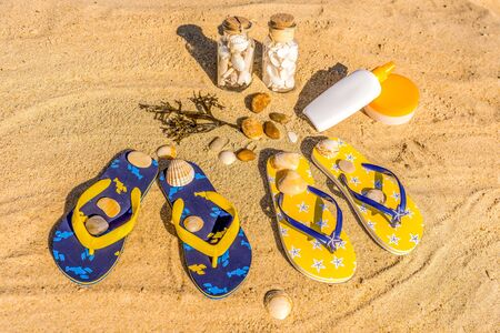 colorful fashion beach accessories on the sand