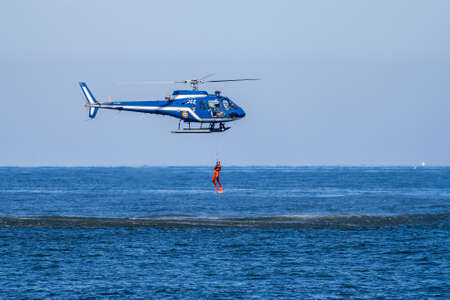 Hossegor, France. 20.05.2020. Rescue helicopter training before the start of the beach season.Soft focus background. Editoriali