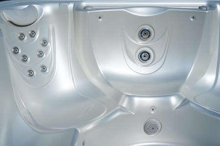 Luxury pearlescent color tub. Closeup of bath tubs at spa. Hydromassage. Archivio Fotografico