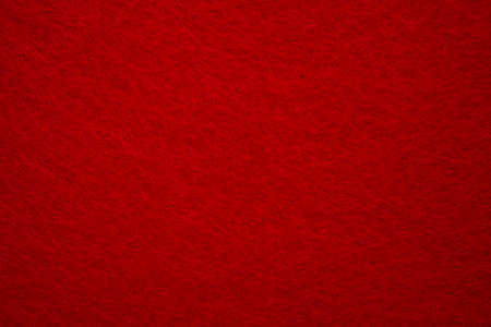 Felt background in red color useful for Christmas backgrounds. High quality photo