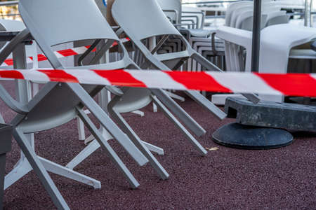 Gastronomy lockdown, tables and chairs of a restaurant, cafe or bar closed due to corona epidemic lockdown. High quality photo Stock Photo