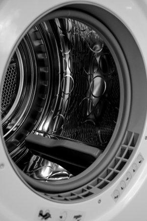Modern washing machine with empty drum, closeup. High quality photo