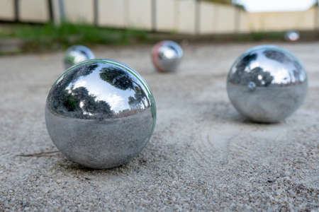 Close-up of steel balls for petanque on a gravel surface, France. Selective focus. High quality photo Banque d'images