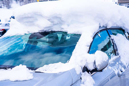 After heavy snowfall car covered with snow standing at city parking. High quality photo Reklamní fotografie