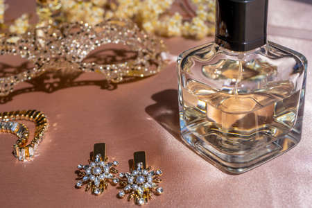 Luxe perfume in beautiful bottle with accessory on toilet table. Selective focus. Luxury beauty brand concept. Selective focus. High quality photo