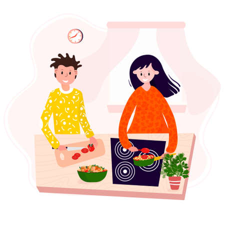 Happy couple stay home and cooking food together. Husband and wife make dinner in kitchen. Man and woman preparation tasty lunch, salad and pasta.