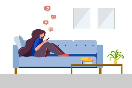 Stay home concept. Young woman on a couch with a smartphone chatting on social networks and receiving messages or mail. surfing the internet. Augmented reality, everyday use of devices and gadgets.