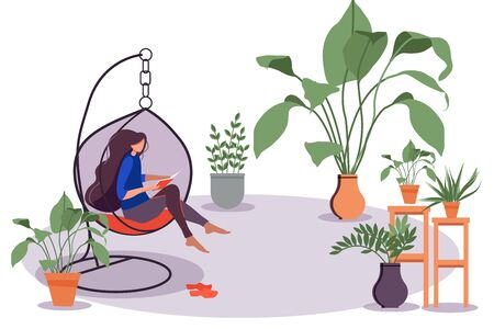 The girl is sitting in a comfortable hanging chair and reading a book. Winter garden, lots of flowers, potted crops. Nice and comfortable interior design. Personal space. stay home