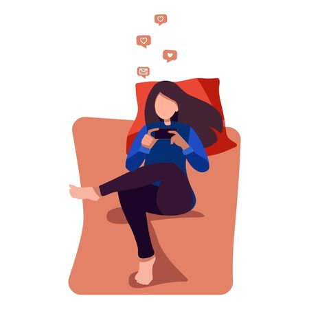 Stay home concept. Young woman on the bed with a smartphone chatting on social networks. Rest, free time. Surfing the internet. Everyday use of devices and gadgets. Unemployment