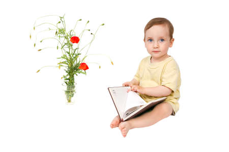 The child is looking through the pages of the book for records  Isolated over white background photo