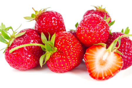 Fresh strawberry is on the surface, isolated on white background photo