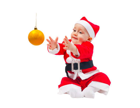 Cute boy in the costume of Santa Claus with the decoration for the Christmas tree isolated on white background photo