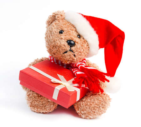 Teddy bear with Christmas gift isolated on white background photo