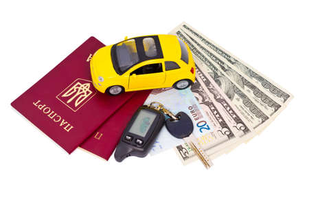 Necessary documents and personal belongings to travel by car isolated on white background  photo