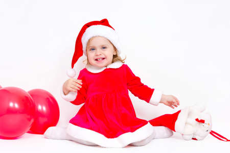 Charming girl happy Christmas gifts on white background photo