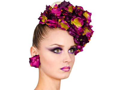 Cute model with decorative make up and beautiful hairstyle of flowers  isolated on white background Reklamní fotografie