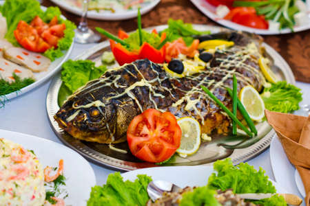 stuffed fish: Delicious stuffed fish with vegetables on the holiday table
