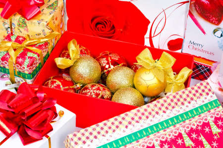 Preparations for the Christmas holiday. Gifts in festive packaging, decoration for Christmas tree, shiny balls with bows photo