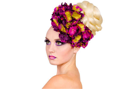 Sexy girl with purple makeup and unusual hairstyle of flowers  isolated on white background Reklamní fotografie