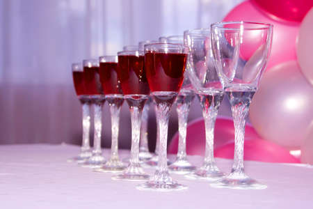 Wine glasses  filled with red wine in row Reklamní fotografie