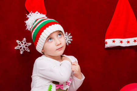 Cute baby in a hat is celebrating Christmas close up Reklamní fotografie