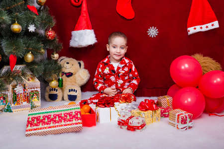 A satisfied child received a large number of gifts for Christmas