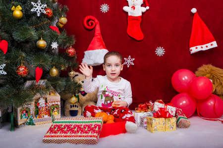 Funny kid says goodbye to Santa Claus Reklamní fotografie
