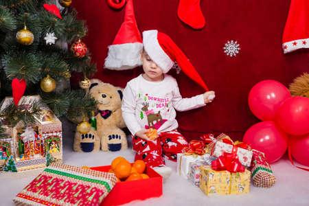 Funny kid takes off his Christmas cap Reklamní fotografie