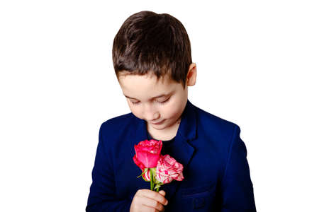 Cute boy holds flowers. Photo isolated on white background. Concept of holidays and birthday. Banque d'images
