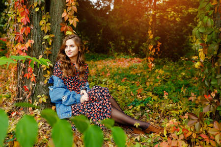 Pretty woman. Autumn stylish outfit. Adorable lady enjoy sunny autumn day. Fashionable clothes. Femininity and tenderness. Fall fashion. Woman walking in autumn park. Archivio Fotografico