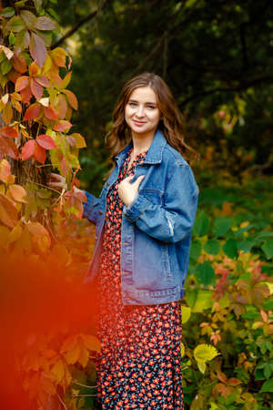 Stylish woman. Autumn stylish outfit. Adorable lady enjoy sunny autumn day. Fashionable clothes. Femininity and tenderness. Fall fashion. Woman walking in autumn park.