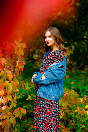 Cute girl. Autumn stylish outfit. Adorable lady enjoy sunny autumn day. Fashionable clothes. Femininity and tenderness. Fall fashion. Woman walking in autumn park.