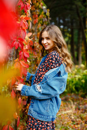 Lovely woman. Autumn stylish outfit. Adorable lady enjoy sunny autumn day. Fashionable clothes. Femininity and tenderness. Fall fashion. Woman walking in autumn park.