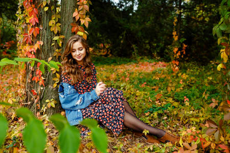 Beautiful woman. Autumn stylish outfit. Adorable lady enjoy sunny autumn day. Fashionable clothes. Femininity and tenderness. Fall fashion. Woman walking in autumn park.