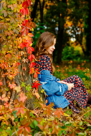 Gorgeous woman. Autumn stylish outfit. Adorable lady enjoy sunny autumn day. Fashionable clothes. Femininity and tenderness. Fall fashion. Woman walking in autumn park.