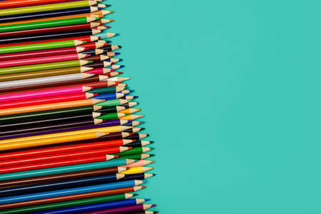 Back to school. Colorful multicolor pencils on blue background. Copy space for text. Flat lay, top view