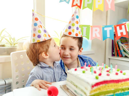 A cute boy wishes his brother a happy birthday. Strong family relationships. Family celebration. Embracing. Congratulations