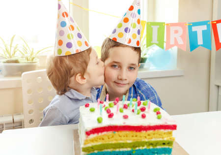 A cute boy wishes his brother a happy birthday. Strong family relationships. Family celebration. Congratulations to the holiday