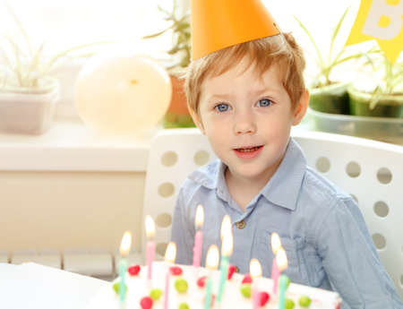 Beautiful caucasian boy. Cake eating. Holidays comfort cozy concept, celebrating birthday. Spending time together, laughting