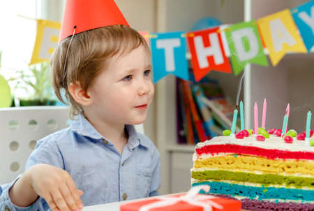 Beautiful caucasian boy. Cake eating. Family holidays, comfort, cozy concept, celebrating birthday. Spending time together, laughting