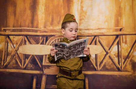 Child are dressed as soldier in retro military uniforms. Little boy on the holiday of May 9, the day of victory in Russia