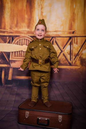 Attractive little russian child in uniform. Holiday Victory Day in Russia in the Great Patriotic War. May 9th, concept Stok Fotoğraf
